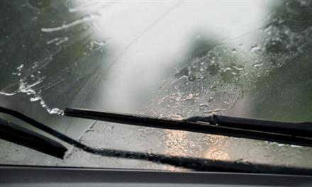 windshield wipers clearing away rain from windshield