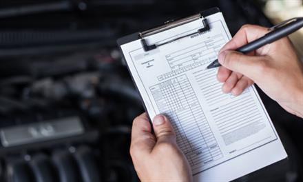 mechanic with vehicle maintenance list